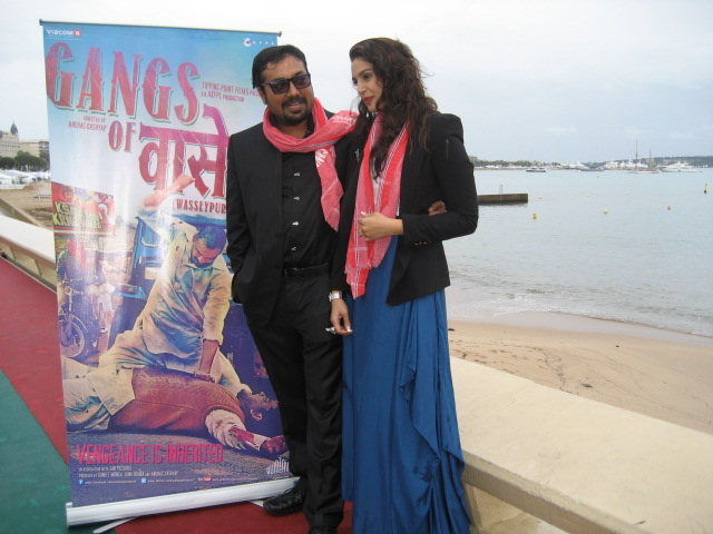Anurag Kashyap and his lead actress Huma Quereshi at a photo session against Cannes coastline